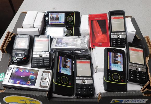 Box of assorted dummy phones