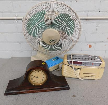 Large electric fan, vintage radio and clock