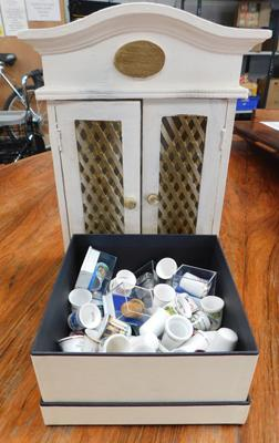 Box of thimbles & small cabinet
