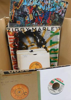 About 50 reggae LPs, 7 & 12 inch singles