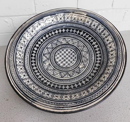 Large studio pottery charger, signed to back - approx. 17 inches, repaired, some age related wear