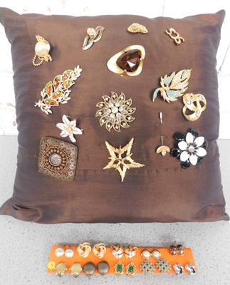 Cushion with vintage brooches and mixed vintage clip on earrings