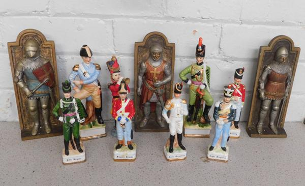 Assortment of toy soldiers and armour plaques