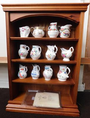 Display rack with 12 Royal Worcester collectable jugs with certificates