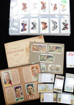 40 pages of mixed cigarette cards +tub of cigatette cards