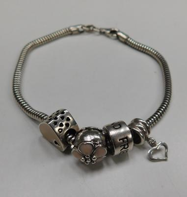 Sterling silver charm bracelet with silver charms