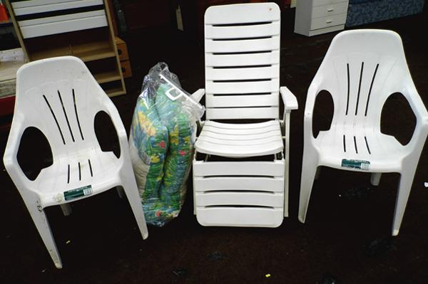 Plastic sun lounger with cushion and two plastic garden chairs