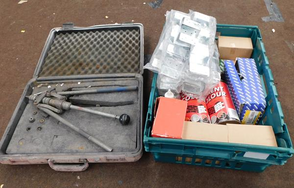 Box of building supplies including bolts, brackets and cement colour