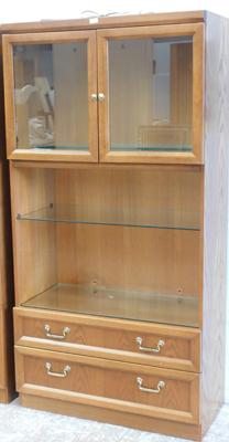Oak coloured glass topped shelving cabinet