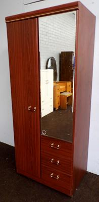 Mirrored wardrobe with drawers section