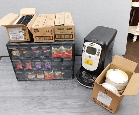Flavia Coffee machine and coffee sachet rack and refill packs and box of saucers
