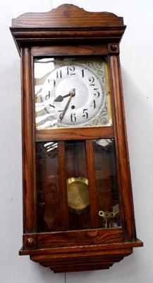 Timepiece American Oak cased wall clock with pendulum and key