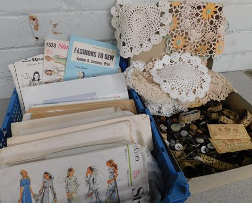 Collection of vintage sewing items including large box of buttons and patterns