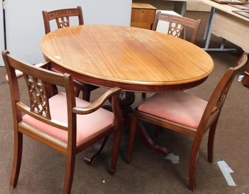 Extending circular table and four chairs