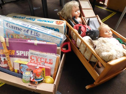 Large collection of vintage toys including games and dolls in cot