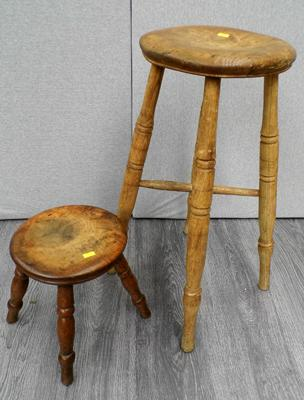 "2 wooden stools (largest 24"" tall)"