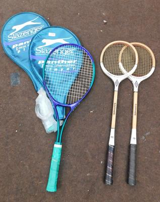 Two Slazenger tennis rackets and two Umbro squash rackets