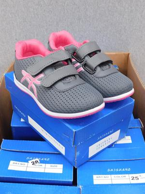Box of 12 new childrens trainers - various sizes