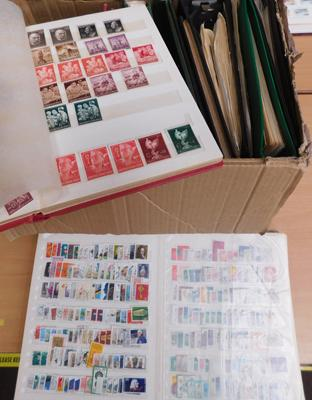 Box containing 12 stamp albums