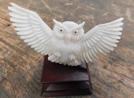 Hand carved bone owl on wooden plinth