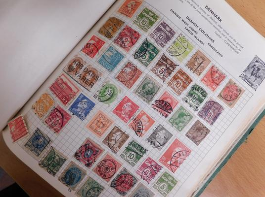 Very well filled album of early commonwealth and world stamps