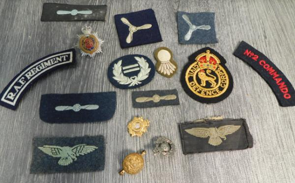 Assortment of military badges