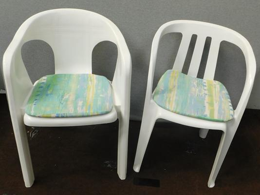 Two white plastic garden chairs & seat cushions