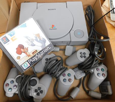 Vintage Sony Playstation 1 & three controllers  + one game