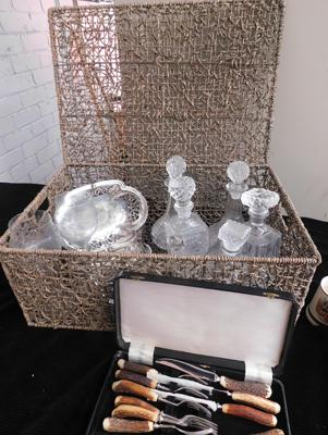 Wicker basket containing vintage decanters, silver plate & bone handled cutlery set