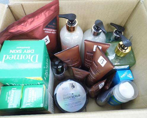 Box of assorted skin care products incl. toner, moisturisers and premium soap