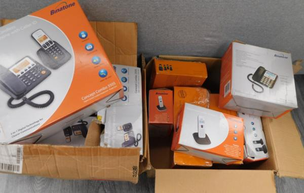 2x Boxes of telephone/ answerphones - factory returns - sold as seen