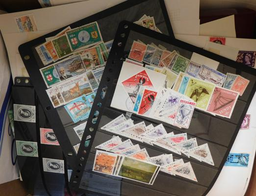 Box containing large quantity of mint and used stamps