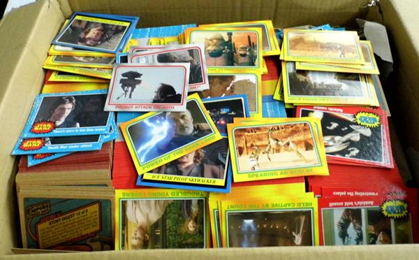 7 full sets of Heritage Topps trading cards and at least 18 full sets of Attack of the Clones resulting in over 2000 trading cards, all near mint condition