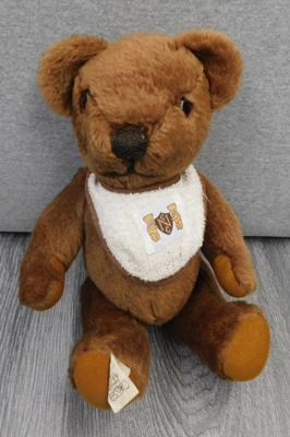Vintage Nisbet Childhood Classic bear by Peggy Nisbet, with original bib & moving arms & legs - 11 inches, good condition