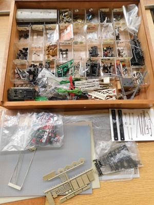 Large box of model railway spare parts