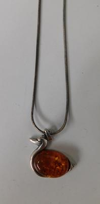 Silver amber duck pendant on silver rope chain