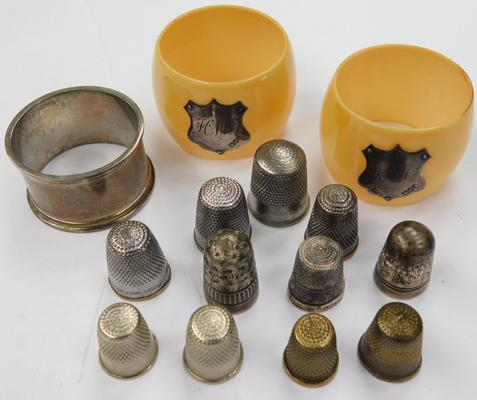 3 x napkin holders - one solid silver, two Bakelite with silver mounts - + 11 thimbles, 2 silver