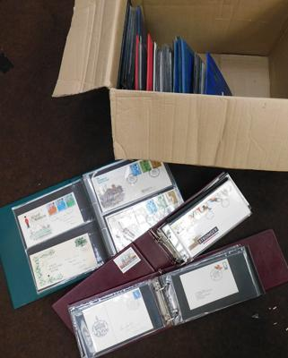 Box containing 8 albums of first day covers