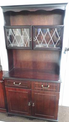 Mahogany coloured dresser with leaded doors