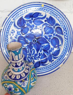 Early Delft charger with vase,