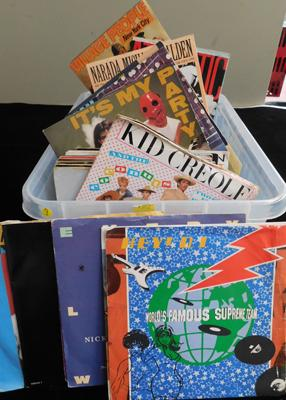 Box of mixed picture sleeves records