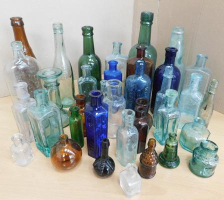 Collection of coloured glass bottles