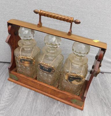 Betjemanns Patent London Tantalus, with three decanters