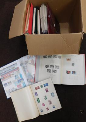 Box containing 7 stamp albums