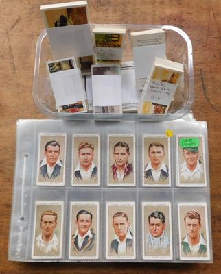 40 pages of cigarette cards & tub of cards