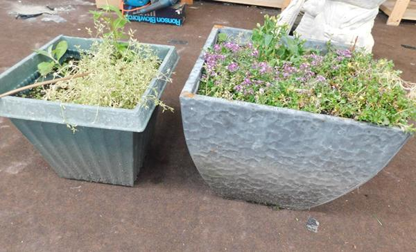 Two garden planters (one metal, one plastic)