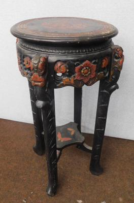 Decorative carved wooden table (29  inches tall)