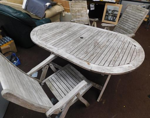 "Oval garden table + 3 chairs approx 42x69"" -requires attention"