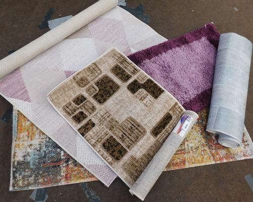 Four rugs - various sizes & roll of vinyl
