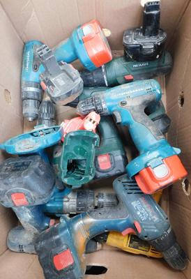 Box of cordless drills & batteries